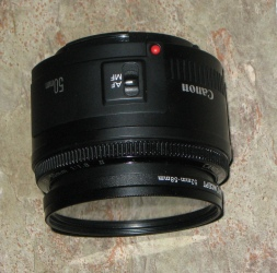 Lens shown with Goya 52 to 58 mm adapter and UV filter attached.