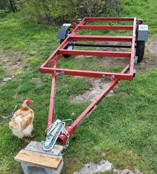 Assembled trailer, chicken looking on in approval