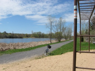 """Calcium Nature Trail, fine gravel isn't easy to ride on with road bike tires but do-able, view of the pond from picnic/playground area.  Trail information on my <a href=""""http://hmienterprises.com/nnytrails/map4.htm"""">NY Trails Calcium Nature Trail page</a>."""
