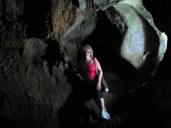 Rose in the cave just before a ride on the subterranean river.
