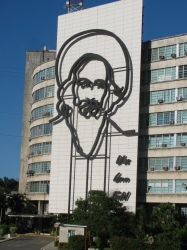 Revolution Square - all tourists are required to visit.  Fidel's name and picture on government building.  Note guard building, many of these surrounding the square.