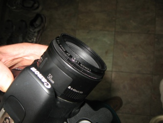 You can see the Goja 52mm to 58mm Step-Up Adapter Ring</a> on the end of my Canon EF 50mm f/1.8 II lens, which has the 52mm threading on it.